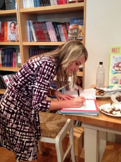 Sally signs my book